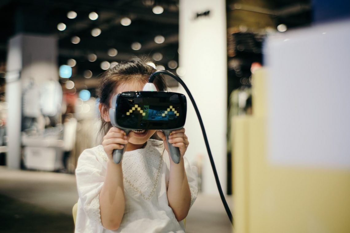 A kid playing with a VR device